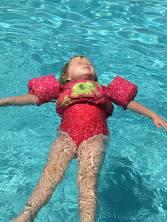 Emma floating on her back Port Orleans 2017